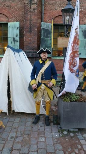 Indelt soldat för Älvsborgs regemente anno 1719 vid Liv kompaniets fana.